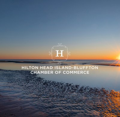 sun set visible on ocean horizon against dark blue sky. chamber logo on top of image