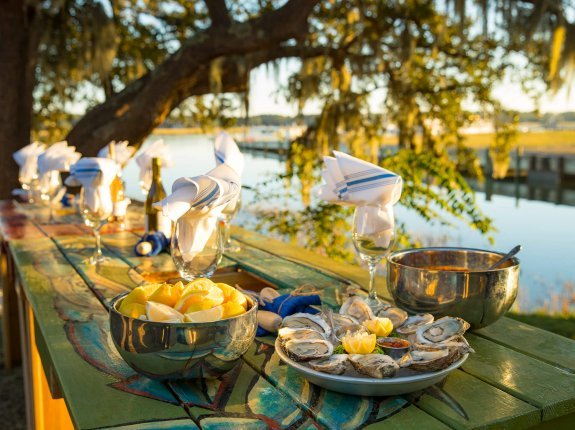 picnic table lined with fresh seafood and wine