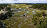 Aerial shot of lowlands with marshes and rivers